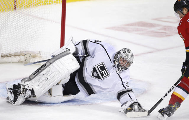 Los Angeles Kings goalie Jack Campbell. left, makes a save against Calgary Flames' Mikael Backlund, from Sweden, during the third period of an NHL hockey game Saturday, Dec. 7, 2019, in Calgary, Alberta. (Larry MacDougal/The Canadian Press via AP)