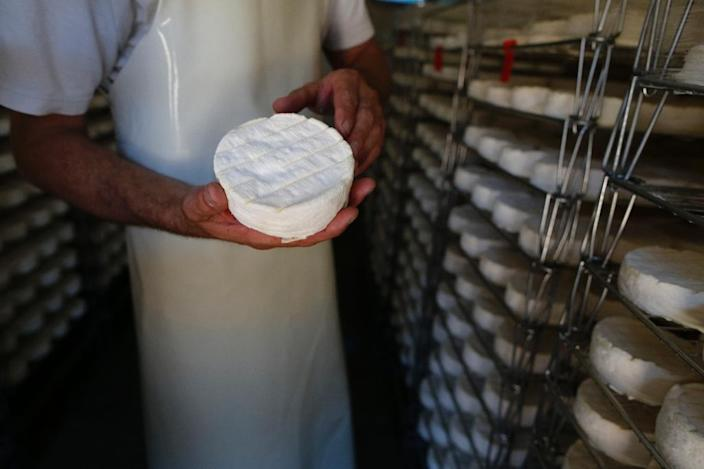 A bid to update the rules governing camembert's production by allowing the use of pasteurised milk has opened a rift in France, whose strict food denominations go back a century (AFP Photo/CHARLY TRIBALLEAU)