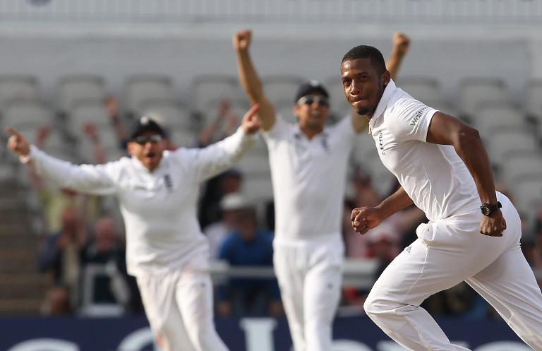 England's Chris Jordan celebrates taking the wicket of India's Pankaj Singh to win the fourth cricket Test match at Old Trafford in Manchester on August 9, 2014
