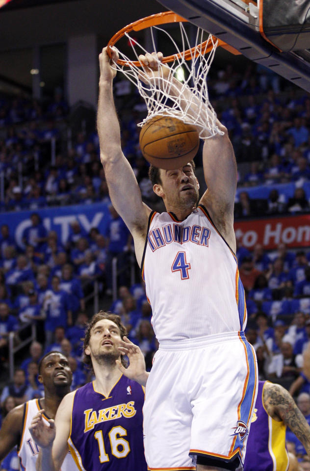 Oklahoma City Thunder center Nick Collison (4) dunks in front of Los Angeles Lakers forward Pau Gasol, of Spain (16) in the second quarter of Game 1 in the second round of the NBA basketball playoffs, in Oklahoma City, Monday, May 14, 2012. (AP Photo/Sue Ogrocki)