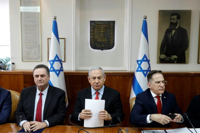 "Flanked by cabinet members, Israeli Prime Minister Benjamin Netanyahu warns Palestinian militant group Islamic Jihad it will have to ""absorb more and more blows"" if it keeps up its rocket fire into Israel"