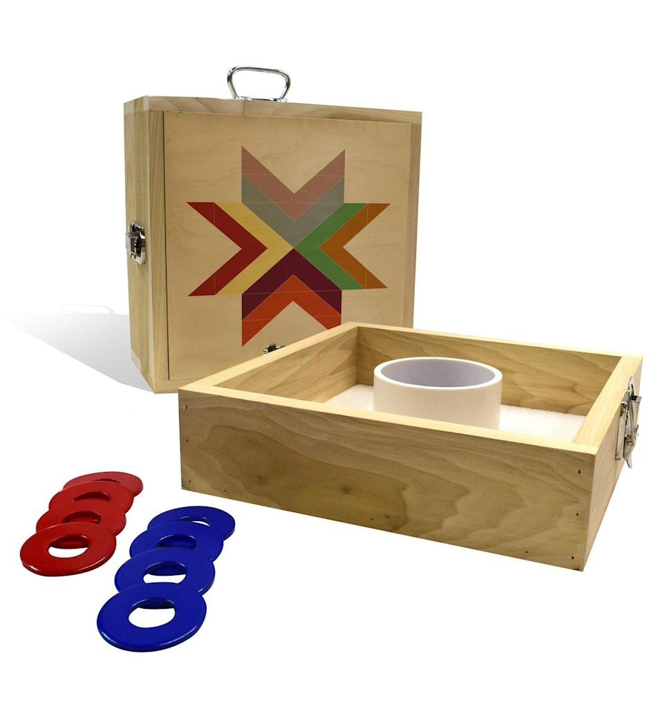 """<p>slickwoodys.com</p><p><strong>$90.00</strong></p><p><a href=""""https://www.slickwoodys.com/products/autumn-star-washer-toss-game"""" rel=""""nofollow noopener"""" target=""""_blank"""" data-ylk=""""slk:Shop Now"""" class=""""link rapid-noclick-resp"""">Shop Now</a></p><p>This washer toss is portable and decorated with a beautiful quilt motif. </p>"""