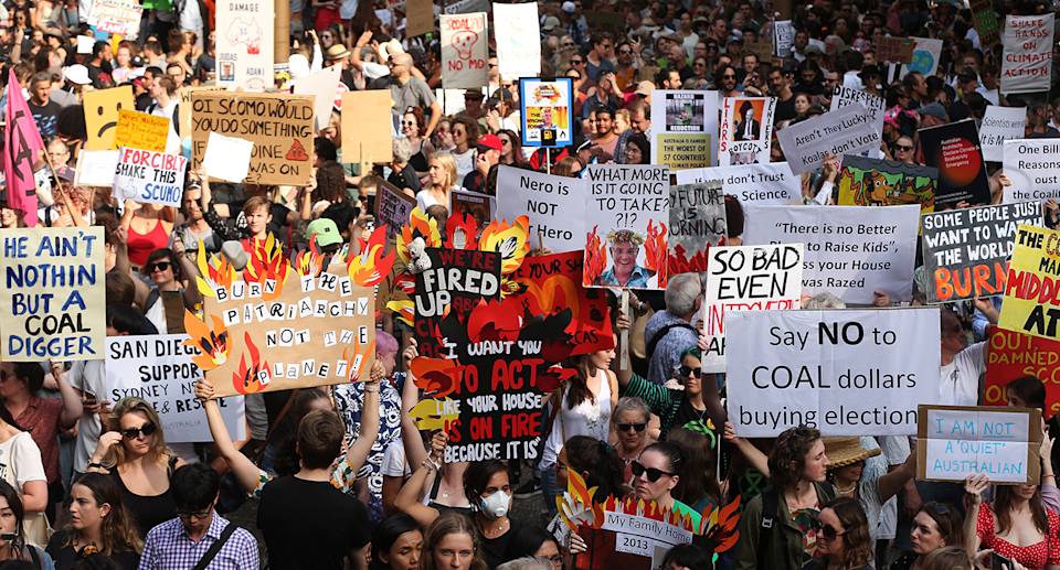 A sea of protesters and signs at a climate march in Sydney.