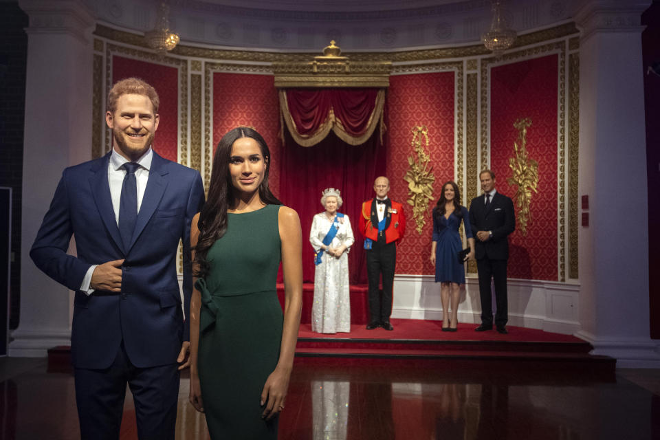 Harry and Meghan waxworks at Madame Tussauds stand seperate to Royal Family exhibit.