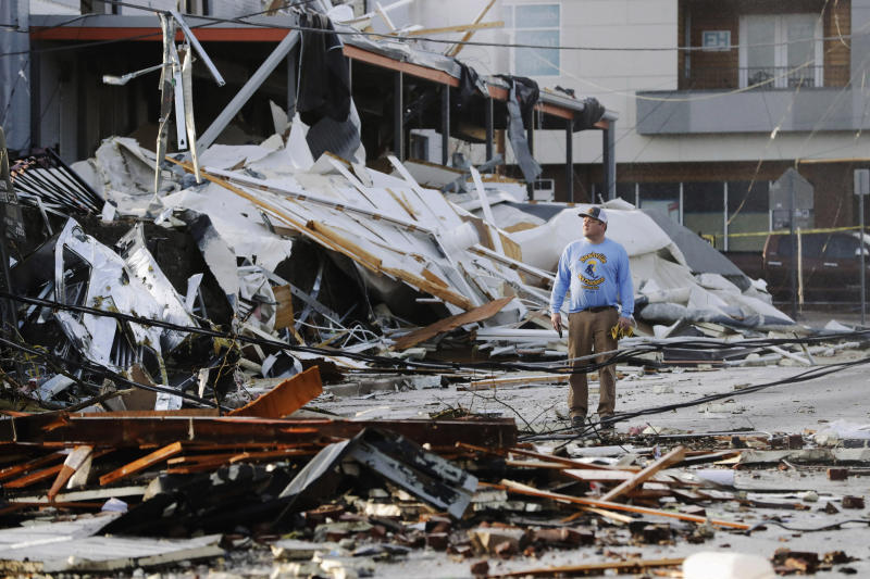 A man looks over buildings destroyed by storms in Nashville.