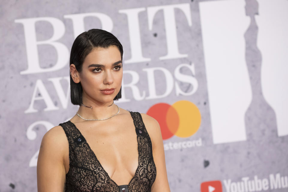 Dua Lipa poses for photographers upon arrival at the Brit Awards 2019 in London, Wednesday, Feb. 20, 2019. (Photo by Vianney Le Caer/Invision/AP)