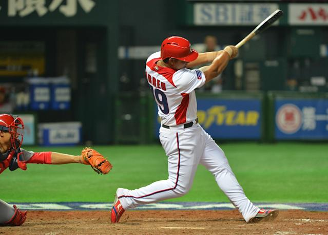 Cuba's Jose Abreu hits a grand slam against China during the fifth inning of their first-round Pool A game in the World Baseball Classic tournament in Fukuoka on March 4, 2013. AFP PHOTO / KAZUHIRO NOGIKAZUHIRO NOGI/AFP/Getty Images