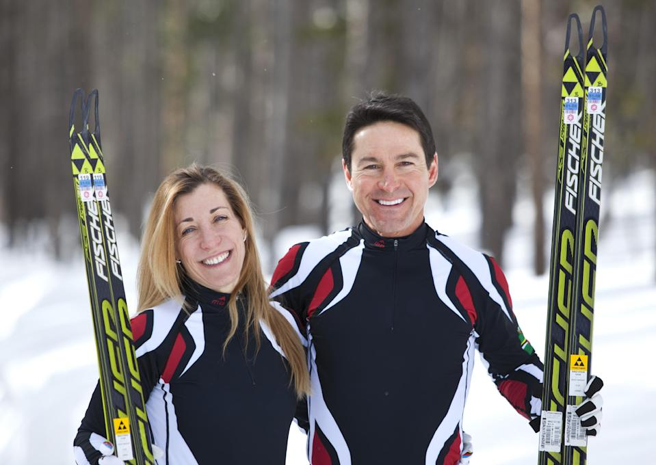 In this photo taken on Monday, Jan. 27, 2014, cross-country skiers Gary and Angelica di Silvestri pose for a photo at the Yellowstone Club in Big Sky, Mont. The American-born man and his Italian-born wife will be representing the tiny Caribbean island nation of Dominica at the Winter Olympics in Sochi next month. The former finance professionals, granted Dominica citizenship for their philanthropic work on the island, are finishing their training in Montana while hastily arranging their own visas, travel logistics and footing the bill for the entire expedition. (AP Photo/Janie Osborne)