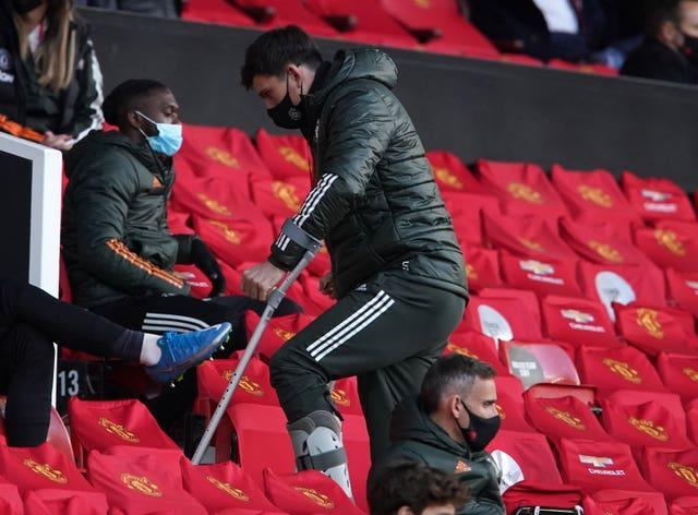 Harry Maguire in the stands on crutches as Manchester United take on Leicester