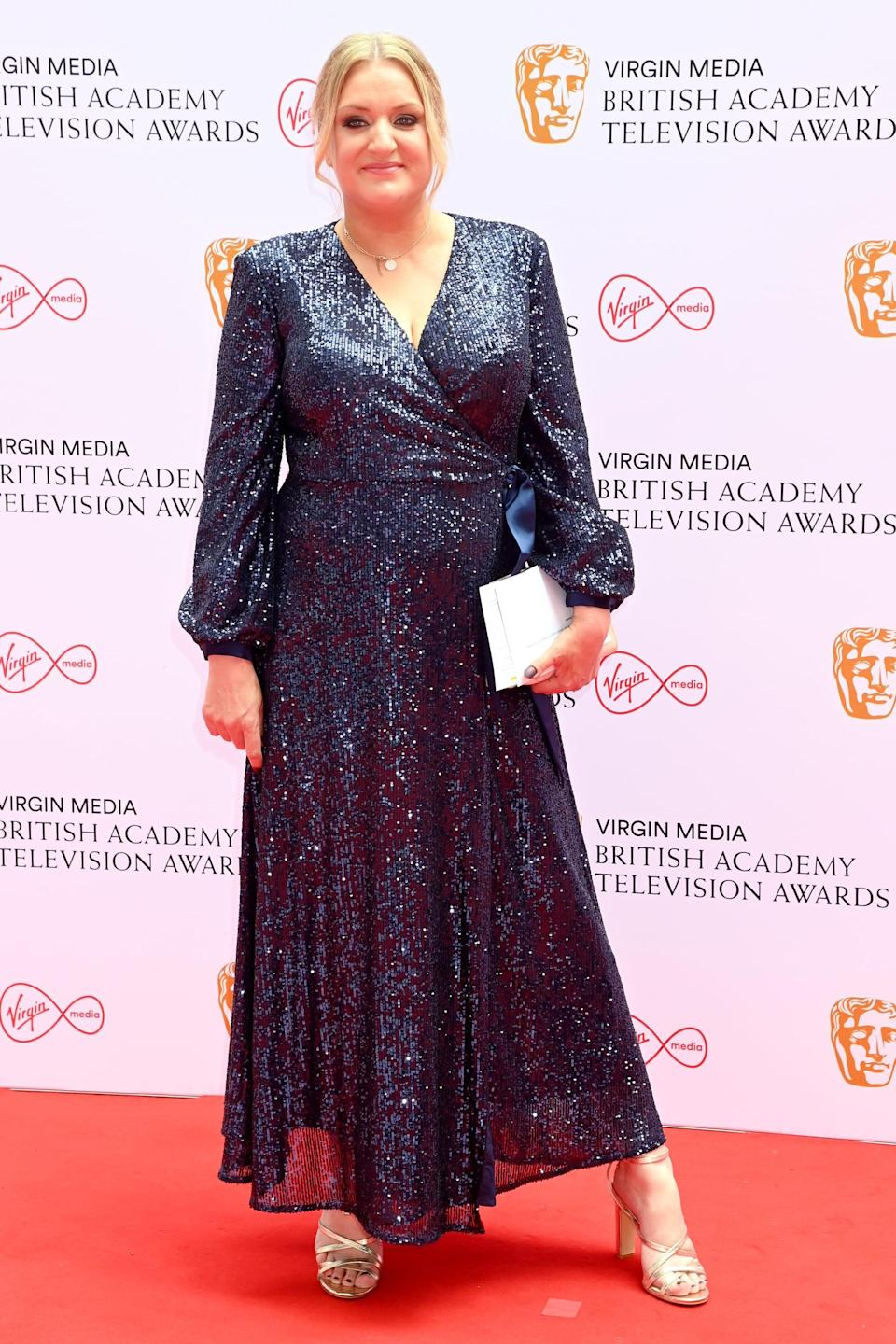 <p>Daisy May Cooper wore a sparkling navy gown. </p>