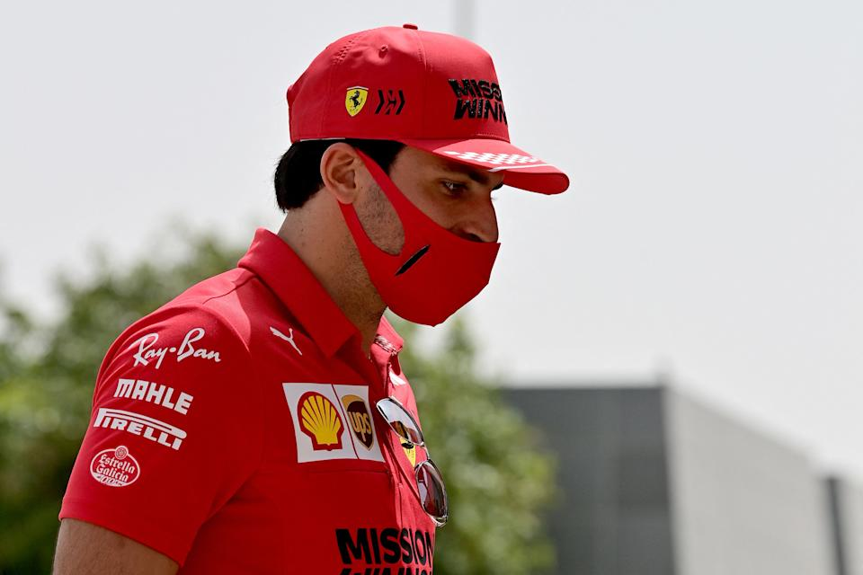 Ferrari's Spanish driver Carlos Sainz Jr arrives at the paddock on March 25, 2021, prior to the the Bahrain Formula One Grand Prix at the Sakhir circuit in Manama. (Photo by Andrej ISAKOVIC / AFP) (Photo by ANDREJ ISAKOVIC/AFP via Getty Images)
