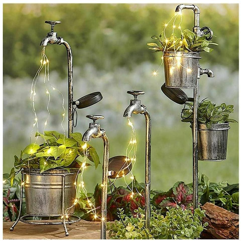 <p>Decorate your garden with these rustic and fun <span>Water Faucet Planter with Solar String Lights</span> ($34).</p>