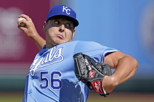 Kansas City Royals starting pitcher Brad Keller throws during the first inning of game one of a baseball doubleheader against the Cincinnati Reds Wednesday, Aug. 19, 2020, in Kansas City, Mo. (AP Photo/Charlie Riedel)
