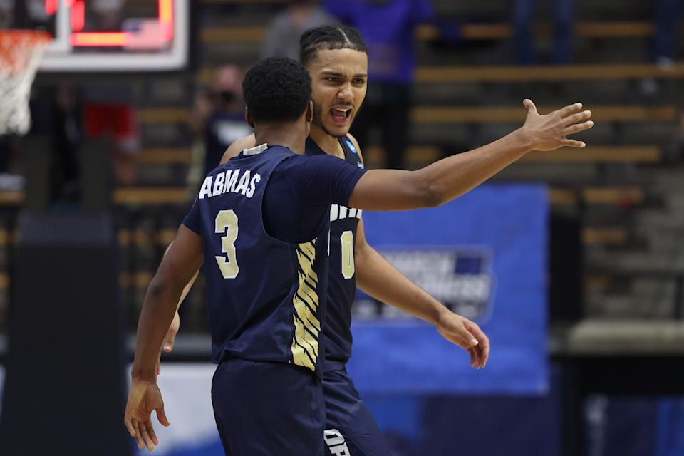 Kevin Obanor #0 and Max Abmas #3 of Oral Roberts react after defeating Ohio State in the NCAA men's tournament on March 19. (Gregory Shamus/Getty Images)