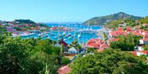 """<p><a href=""""https://www.bestproducts.com/fun-things-to-do/g21237324/most-beautiful-islands-in-the-world/"""" rel=""""nofollow noopener"""" target=""""_blank"""" data-ylk=""""slk:Saint-Barthélemy"""" class=""""link rapid-noclick-resp"""">Saint-Barthélemy</a>, or St. Bart's, in the French West Indies, has long been an exclusive playground for the rich and famous (it's made a <a href=""""https://observer.com/2018/12/st-barths-hotels-book-now-caribbean-travel-vacation/"""" rel=""""nofollow noopener"""" target=""""_blank"""" data-ylk=""""slk:remarkable comeback"""" class=""""link rapid-noclick-resp"""">remarkable comeback</a> after recent hurricanes), who dock their yacht in the harbor, swim in beaches like Grand Salines, and stroll in the cutesy capital of Gustavia, filled with designer boutiques and chic cafés straight out of St. Tropez. </p>"""