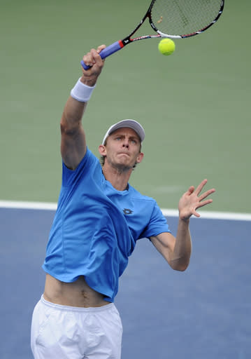 Kevin Anderson, of South Africa, reaches for the ball against Donald Young during a match at the Citi Open tennis tournament, Friday, Aug. 1, 2014, in Washington. (AP Photo/Nick Wass)
