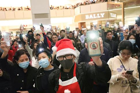 Anti-government protesters gather in New Town Plaza shopping mall in Shatin on Christmas Eve. Photo: Felix Wong