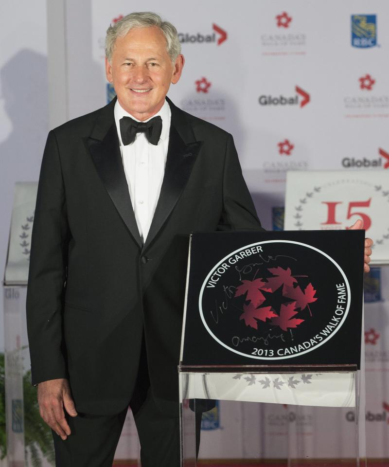 Actor Victor Garber stands by his star during Canada's Walk of Fame induction ceremonies in Toronto, September 21, 2013. REUTERS/Mark Blinch (CANADA - Tags: ENTERTAINMENT)