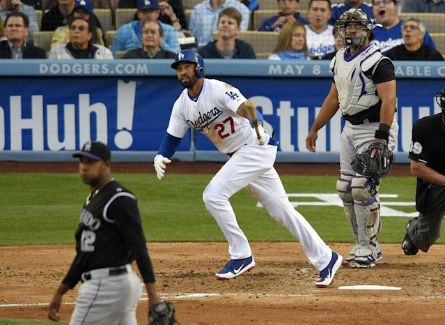 Los Angeles Dodgers' Matt Kemp, center, watches his solo home, between Colorado Rockies starting pitcher Juan Nicasio, left, and catcher Wilin Rosario during the third inning of a baseball game, Saturday, April 26, 2014, in Los Angeles. (AP Photo/Mark J. Terrill)