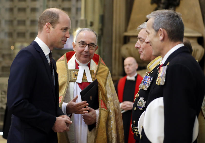Britain's Prince William, Duke of Cambridge, left, arrives to attend a service to recognise fifty years of continuous deterrent at sea in his capacity as Commodore-in-Chief of the Submarine Service, at Westminster Abbey in London, Friday, May 3, 2019. (AP Photo/Kirsty Wigglesworth, Pool)