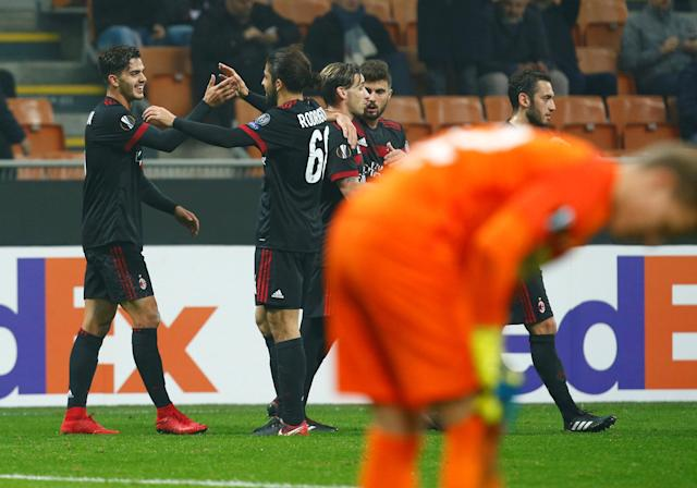Soccer Football - Europa League - AC Milan vs FK Austria Wien - San Siro, Milan, Italy - November 23, 2017 AC Milan's Andre Silva celebrates scoring their second goal with Ricardo Rodriguez REUTERS/Alessandro Garofalo