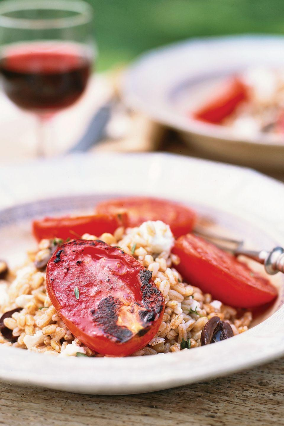 "The natural nuttiness of farro (whole emmer wheat) marries beautifully with the saltiness of the olives and the sweetness of the broiled 'Roma' tomatoes. Serve with a lightly chilled fruity red wine. To save time, substitute a quick-cooking grain or pasta such as couscous, orzo, or instant brown rice for farro. <a href=""https://www.countryliving.com/food-drinks/recipes/a1192/broiled-tomatoes-farro-salad-3299/"" rel=""nofollow noopener"" target=""_blank"" data-ylk=""slk:Get the recipe."" class=""link rapid-noclick-resp""><strong>Get the recipe.</strong></a>"