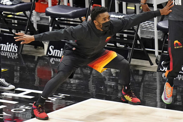 Utah Jazz guard Donovan Mitchell reacts in the bench area during the second half of the team's NBA basketball game against the Atlanta Hawks on Friday, Jan. 15, 2021, in Salt Lake City. (AP Photo/Rick Bowmer)