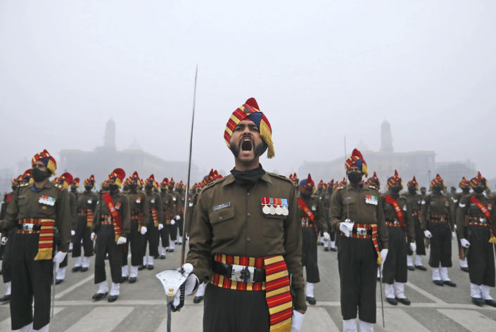 Major Piyush Sharma, from Indian Army Bengal Sappers, gives a command to his contingent for marching during rehearsals for the upcoming Republic Day parade at the Raisina hills, the government seat of power, in New Delhi, India, Monday, Jan. 18, 2021. Republic Day marks the anniversary of the adoption of the country's constitution on Jan. 26, 1950. Thousands congregate on Rajpath, a ceremonial boulevard in New Delhi, to watch a flamboyant display of the country's military power and cultural diversity. (AP Photo/Manish Swarup)