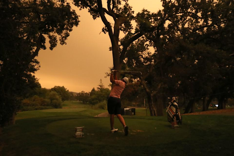 Matt NeSmith practices at the Safeway Open on Wednesday with orange skies from the wildfires. (Photo by Jed Jacobsohn/Getty Images)