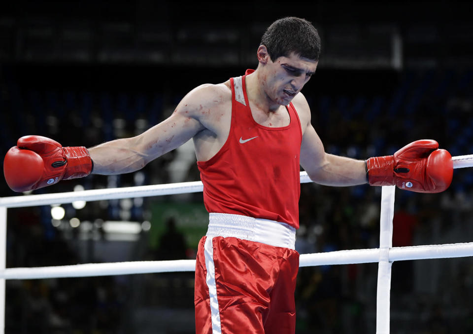 <p>Armenia's Vladimir Margaryan reacts after losing to Cuba's Roniel Iglesias with a technical knockout for injury in the first round during a men's welterweight 69-kg preliminary boxing match at the 2016 Summer Olympics in Rio de Janeiro, Brazil, Thursday, Aug. 11, 2016. (AP Photo/Frank Franklin II) </p>