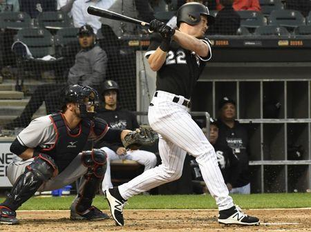 Jun 11, 2018; Chicago, IL, USA; Chicago White Sox left fielder Charlie Tilson (22) hits a single against the Cleveland Indians during the second inning at Guaranteed Rate Field. Mandatory Credit: David Banks-USA TODAY Sports