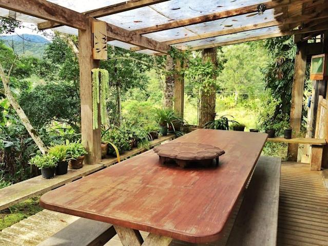 <p>The breakfast table lets you experience the beautiful rainforest morning with a little protection from the elements. (Airbnb) </p>