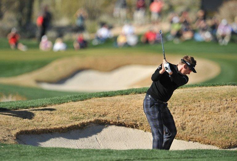 Ian Poulter plays his way out of a bunker in the quarter-finals of the WGC Match Play Championship on February 23, 2013