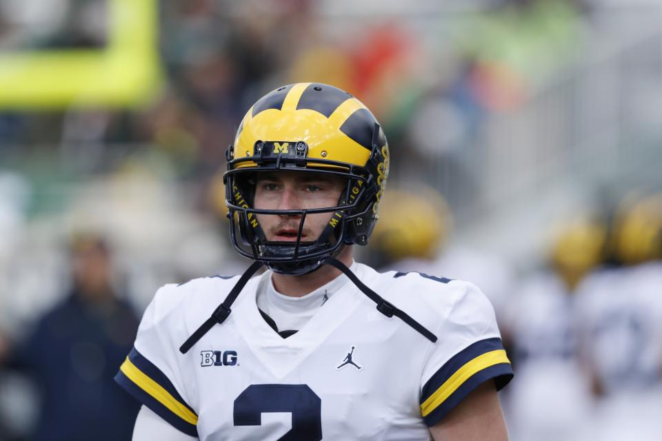 Michigan quarterback Shea Patterson is seen during warmups before the first half of an NCAA college football game against Michigan State , Saturday, Oct. 20, 2018, in East Lansing, Mich. (AP Photo/Carlos Osorio)