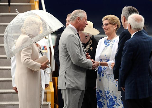 Britain's Prince Charles and Camilla, Duchess of Cornwall are greeted by Ontario Premier Kathleen Wynne as they arrive at Canadian Forces Base Trenton in Trenton, Ontario, Canada, June 30, 2017. REUTERS/Adrian Wyld/Pool