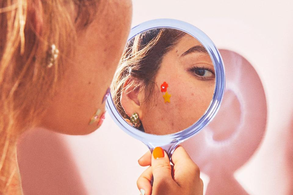 """<h2>Tip #1: Step Away From the Extraction Tool</h2> <p>If you've ever wondered how those tiny dark spots ended up on your face in the first place, the answer is this: pimples are a major culprit that usually leave marks behind. You also increase the chances of dark scars on your skin if you pick at your blemishes. Dr. Henry says picking and squeezing causes inflammation and blood production at the breakout site, which often leads to bruising that turns into a brown scar.</p> <p>As hard as it might be to let your pimples roam free, try to refrain from picking at them and creating more scars. Then, maintain a gentle <a href=""""https://www.popsugar.com/beauty/Best-Acne-Treatments-Dermatologists-Use-45486951"""" class=""""link rapid-noclick-resp"""" rel=""""nofollow noopener"""" target=""""_blank"""" data-ylk=""""slk:acne treatment plan"""">acne treatment plan</a> to keep breakouts at bay. Dr. Henry's advice? """"Simple is better when it comes to treating hyperpigmentation because you don't want to make your condition worse.""""</p> <h2>Tip #2: Lean On Exfoliating Ingredients</h2> <p>Every <a href=""""https://www.popsugar.com/beauty/Best-Skin-Care-Routine-25977852"""" class=""""link rapid-noclick-resp"""" rel=""""nofollow noopener"""" target=""""_blank"""" data-ylk=""""slk:skin-care routine"""">skin-care routine</a> should include an exfoliating step every once in a while, but this is especially true for people with hyperpigmentation and dark spots. The three most trusted by derms to fade marks fast: retinol, glycolic acid, and salicylic acid. </p> <p>""""<a href=""""https://www.popsugar.com/beauty/Best-Retinols-Derms-Use-45417355"""" class=""""link rapid-noclick-resp"""" rel=""""nofollow noopener"""" target=""""_blank"""" data-ylk=""""slk:[Retinol] helps unblock pores"""">[Retinol] helps unblock pores</a> and fights acne, which will result in the development of fewer new spots,"""" said Dr. Henry. """"It's also anti-inflammatory and will help lighten dark spots.""""</p> <p>Everything else you put on your skin should be gently exfoliating and moisturizing. """"Look for products"""