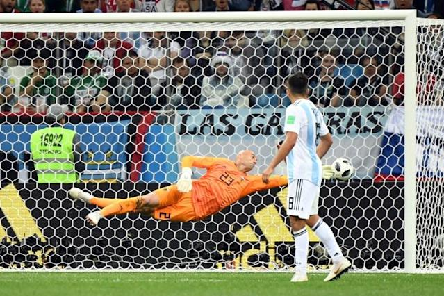 Argentina's goalkeeper Willy Caballero a goal by Croatia