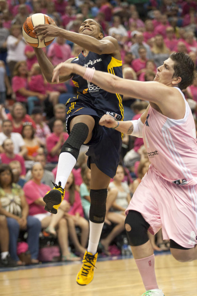 Indiana Fever forward Tamika Catchings, left, shoots against Minnesota Lynx center Janel McCarville (4) during the second half of a WNBA basketball game on Saturday, Aug. 24, 2013, in Minneapolis. Catchings had a team-high 22 points but Minnesota won 84-77. (AP Photo/Paul Battaglia)