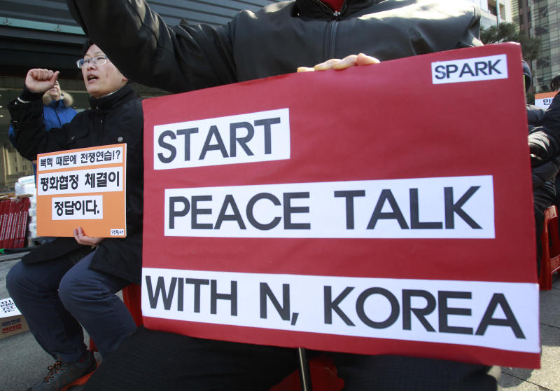 A protester shouts slogans during a rally opposing the scheduled visit of Secretary of State John Kerry near the U.S. embassy in Seoul, South Korea, Tuesday, Feb. 11, 2014. Kerry will visit South Korea on Thursday to discuss issues of mutual concerns, including efforts to denuclearize North Korea.(AP Photo/Ahn Young-joon)