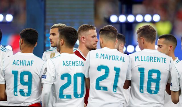 Soccer Football - Champions League Final - Real Madrid v Liverpool - NSC Olympic Stadium, Kiev, Ukraine - May 26, 2018 Real Madrid players applaud Liverpool players as they make their way to collect their runners up medals REUTERS/Andrew Boyers