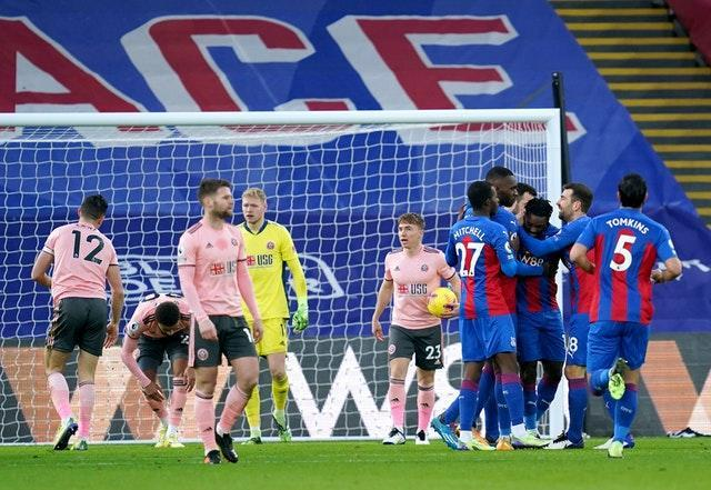 Sheffield United players react as Jeffrey Schlupp and Crystal Palace celebrate their first goal