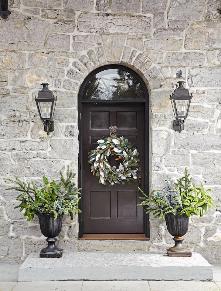 <p>Hanging up a wreath is the best way to give your front porch a little fall flair. And it's super easy. Go all out with a harvest wreath or keep it understated with an elevated seasonal wreath like this one. </p>