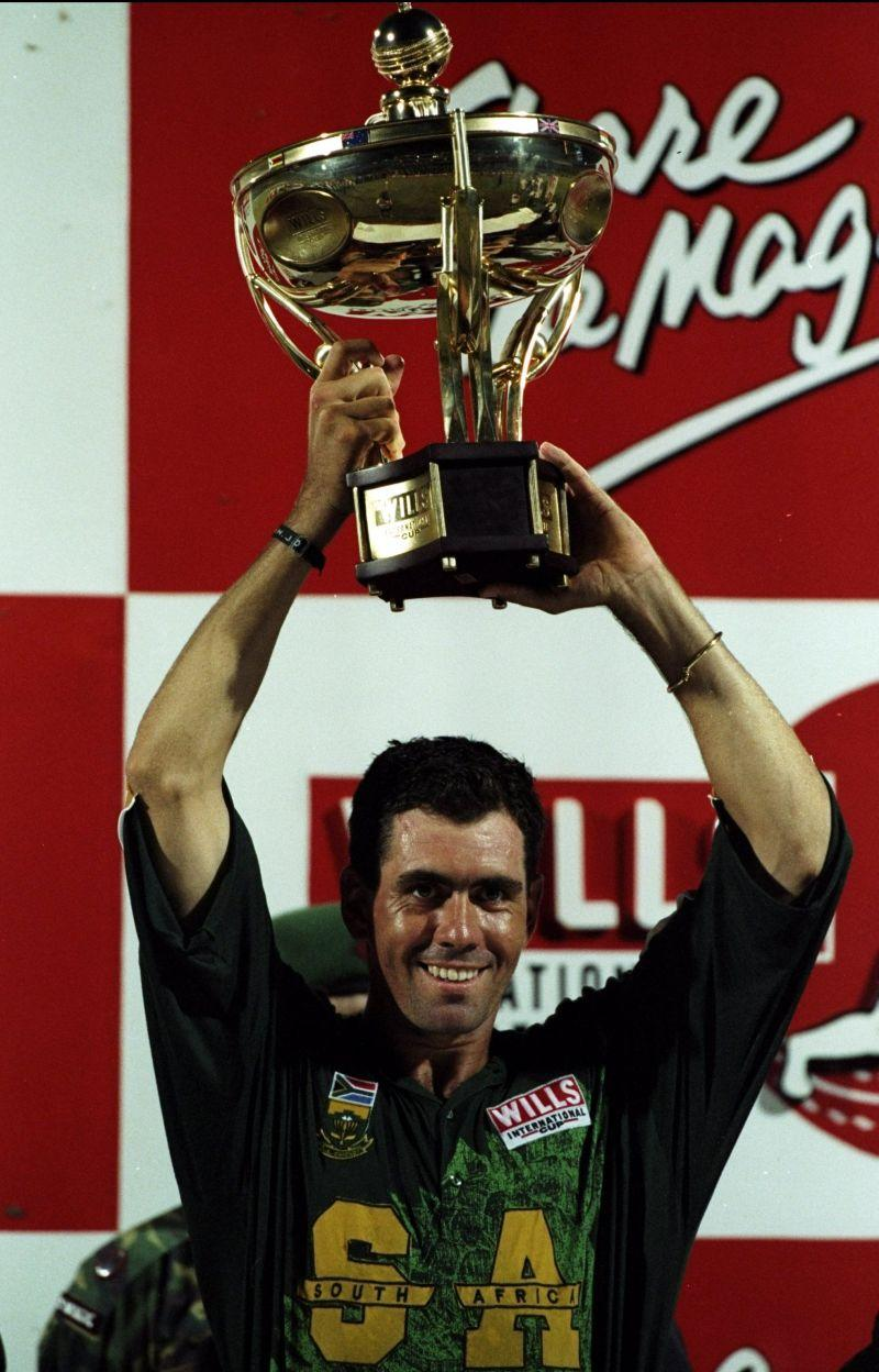 The South African captain Hansie Cronje lifts the ICC Trophy