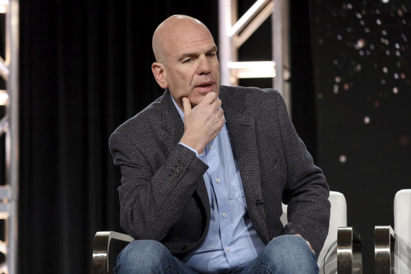 """FILE - This Jan. 15, 2020 file photo shows David Simon speaking at the """"The Plot Against America"""" panel during the HBO TCA 2020 Winter Press Tour in Pasadena, Calif. The 6-part mini-series, based on the novel by the late Philip Roth, premieres Monday, March 16. (Photo by Willy Sanjuan/Invision/AP, File)"""