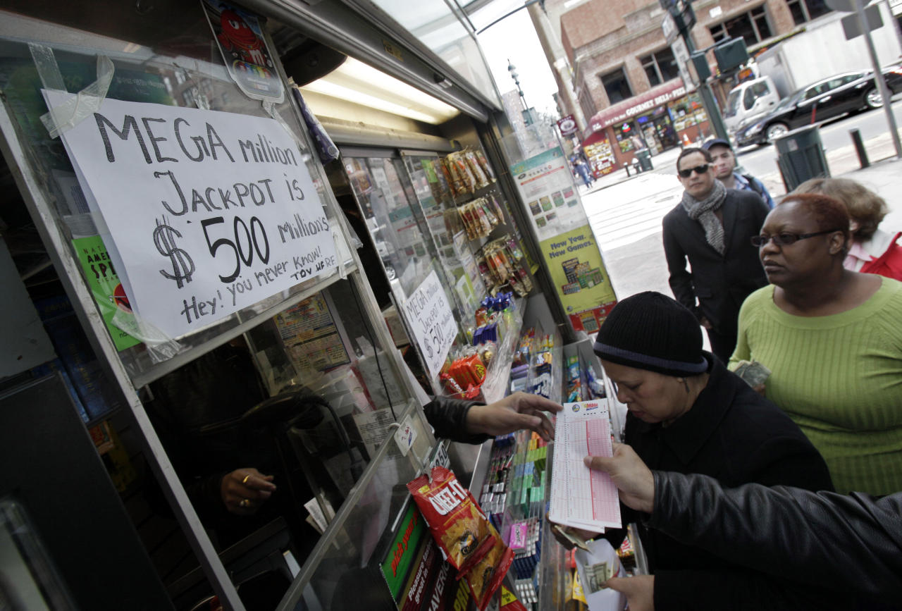 Mega Millions lottery contestants queue up for tickets for Friday's $500-million game at a corner newsstand in New York, Thursday, March 29, 2012. Forget setting up a charity or establishing a trust, the winner of the $500 million Mega Millions jackpot could save teachers' jobs or help pay for Medicaid-funded doctor appointments in their home state just by paying taxes. (AP Photo/Richard Drew)