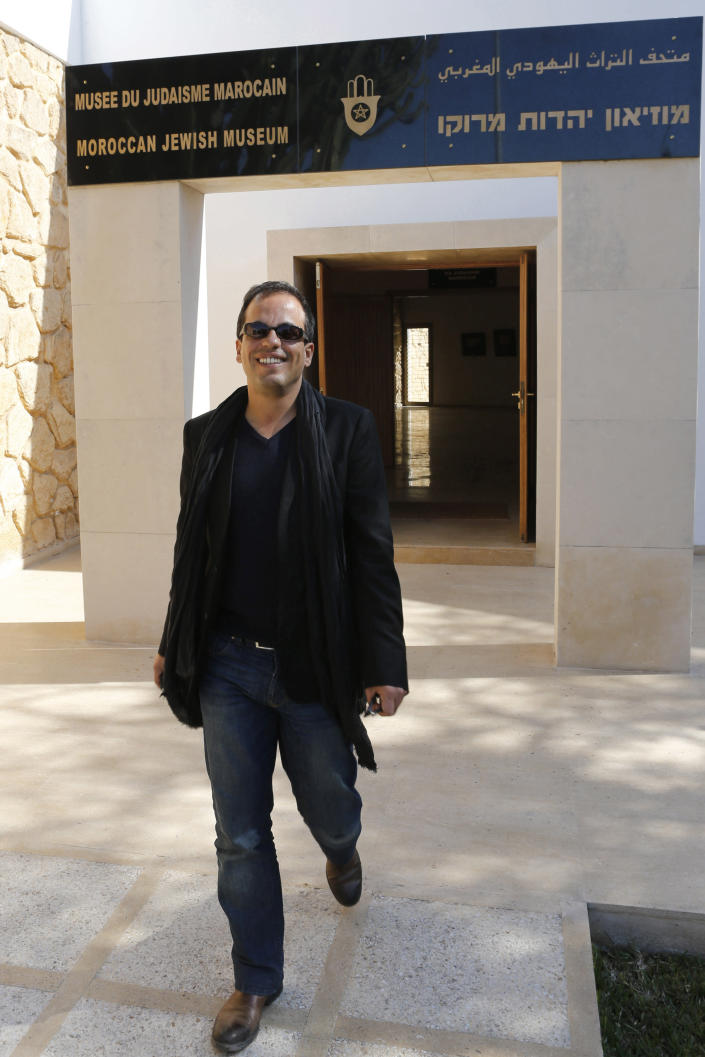 """Kamal Hachkar, director of the documentary """"Tinghir to Jerusalem"""" walks outside Casablanca's Museum of Moroccan Judaism, in this Friday, Feb, 15, 2013 photo. Once home to some 300,000 Jews, the largest population in the Arab world, Morocco is increasingly taking a fresh look at its long history with Judaism. (AP Photo/Abdeljalil Bounhar)"""