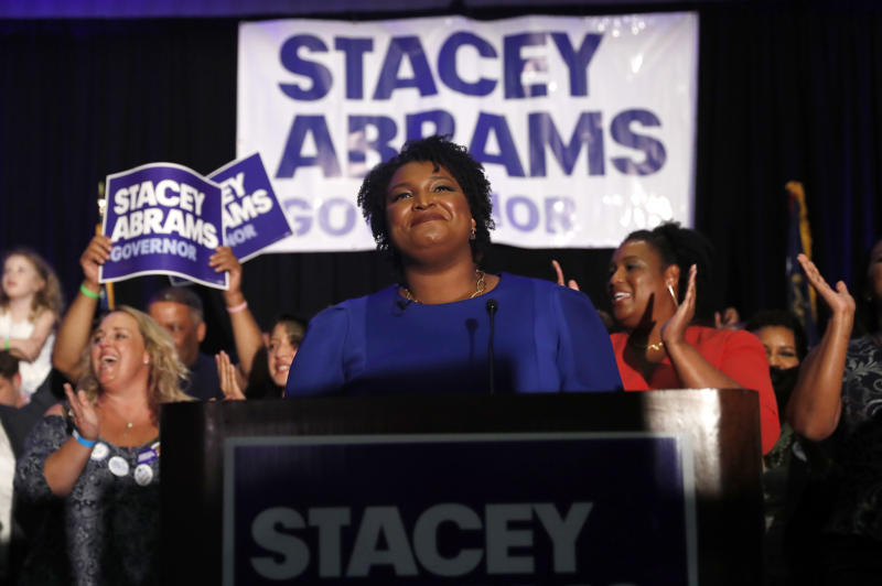 FILE - In this May 22, 2018, file photo, Georgia Democratic gubernatorial candidate Stacey Abrams smiles before speaking to supporters during an election-night watch party in Atlanta. More women than ever before have won their primaries for governor, U.S. Senate and House this year. That's setting a record and paving the way for battles in November that could significantly increase the number of women in elected office. (AP Photo/John Bazemore, File)