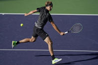 Alexander Zverev, of Germany, returns a shot to Andy Murray, of Britain, at the BNP Paribas Open tennis tournament Tuesday, Oct. 12, 2021, in Indian Wells, Calif. (AP Photo/Mark J. Terrill)