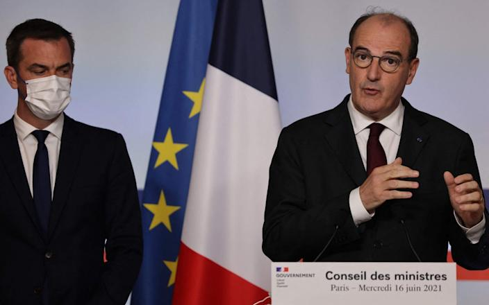 French Health Minister Olivier Veran and Prime Minister Jean Castex give a press conference - THOMAS COEX/AFP