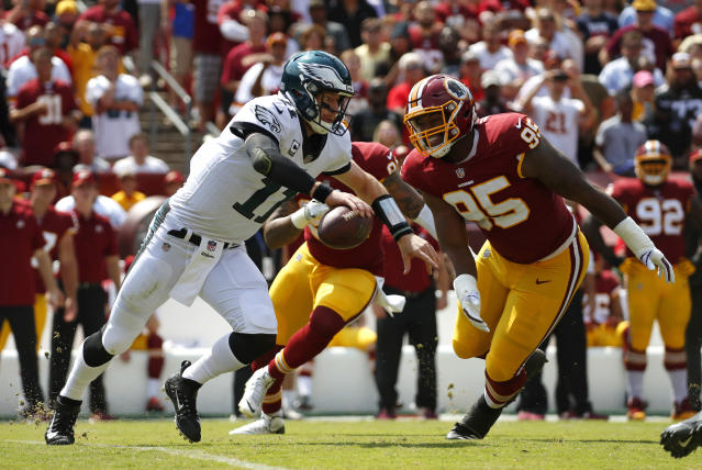 Catch me if you can: Eagles QB Carson Wentz proved elusive against Washington on Sunday. (AP)